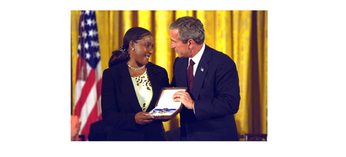 President George W. Bush Presents the Presidential Medal of Freedom to Makaziwe Mandela on Behalf of her Father, Nelson Mandela, 07/09/2002 (National Archives Identifier 7431401)