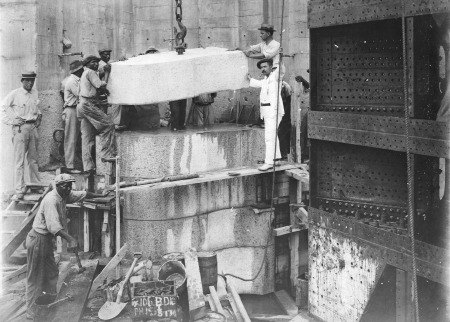 Placing granite in the hollow quoin. Dry Dock No. 1, Balboa, June 21, 1915. (National Archives Local Identifier 185-HR-4-26J164)