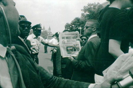 """Racial Demonstration and Parade in D. C."" Malcolm X, leader of the Black Muslims participating in the demonstration in front of Justice Dept. 6/14/1963 (306-SS-16-820-J-28)"