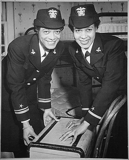 """Lt.(jg.) Harriet Ida Pickens and Ens. Frances Wills, first Negro Waves to be commissioned. They were members of the final graduating class at Naval Reserve Midshipmen's School (WR) Northampton, MA."" (NAID 520670)"