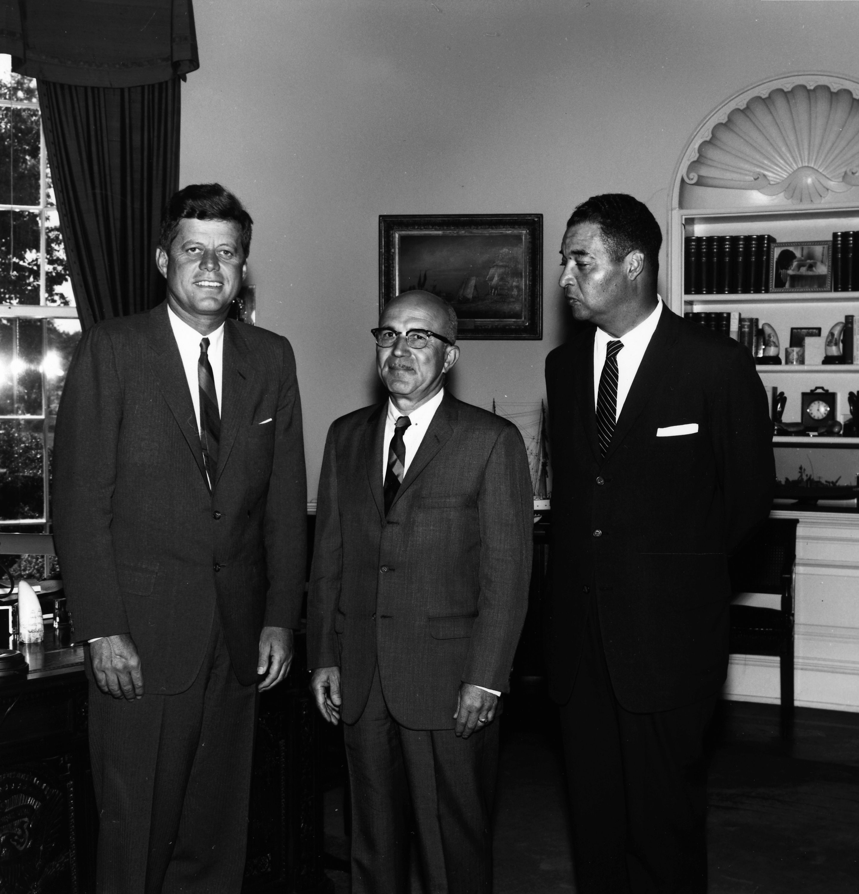 rediscovering black history page  president kennedy meets us f hawkins center and louis martin right