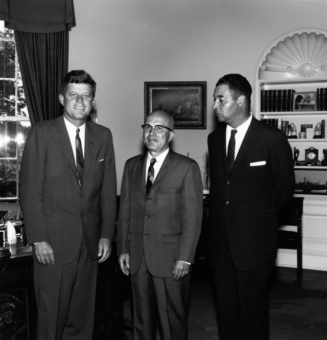 "President Kennedy meets with Augustus F. Hawkins (center) and Louis Martin (right) in the Oval Office, August 22, 1962. Please credit: ""Robert Knudsen/John F. Kennedy Presidential Library, Boston."""